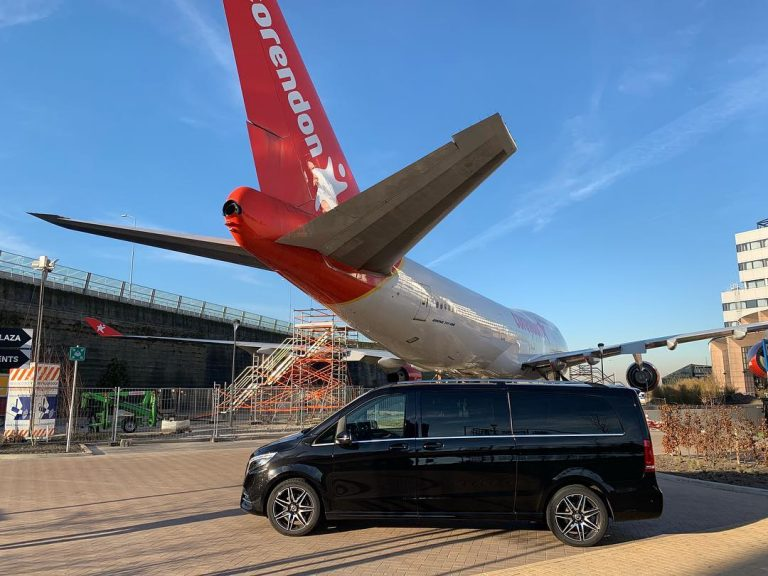 Mercedes van in front of a Corendon airplane for airport transfer