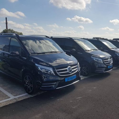 Event transportation for bigger groups, row of Mercedes minivans