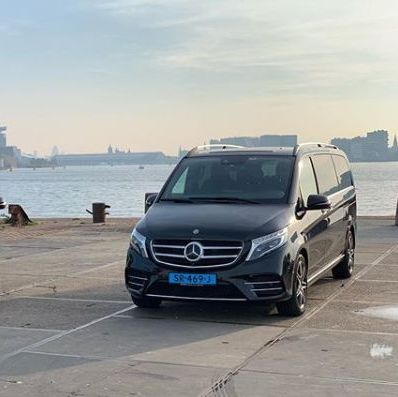 Mercedes van in front of the water